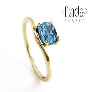 Szellő arany gyűrű kék topázzal