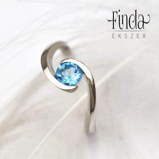 ölelés fehérarany eljegyzési gyűrű kék topázzal